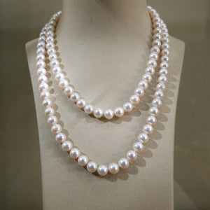 Freshwater pearl necklace featuring 10 to 11 mm pearls measuring 48 inches in length.