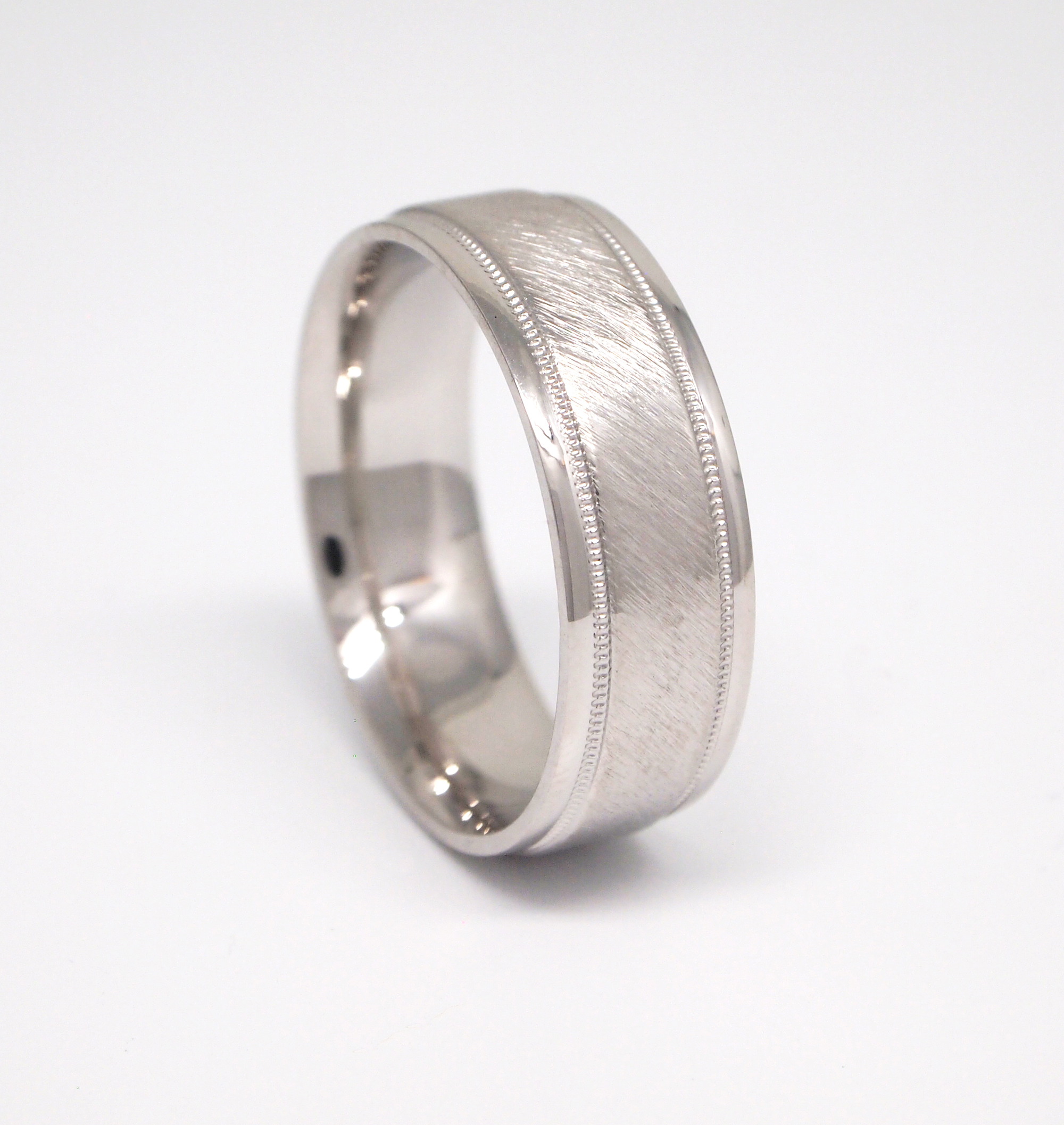 14k white gold 7mm men's wedding band with a bark finish center, bright rounded edges, and milgrain channels.