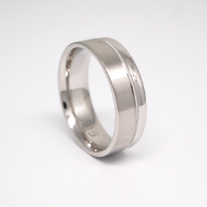 14k white gold 7mm men's wedding band featuring a satin offset side with smaller bright side and milgrain channel.