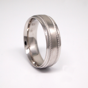 14k white gold 7mm men's wedding band featuring a satin center, large milgrain channels, and bright rolled edges.