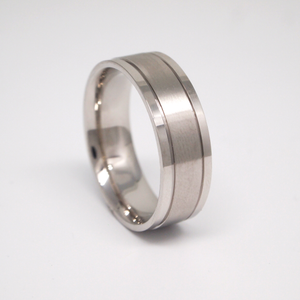 14k white gold 7mm men's wedding band featuring a satin center, small channels, and bright edges.