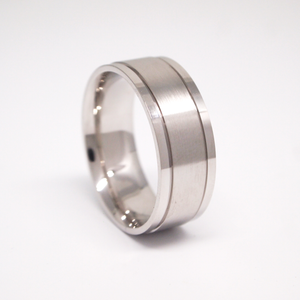 14K white gold 8mm man's wedding band featuring a satin center with bright edges and thin channels.