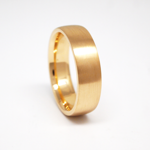 14K yellow gold 6mm heavy weight men's wedding band featuring a low dome with a satin finish.