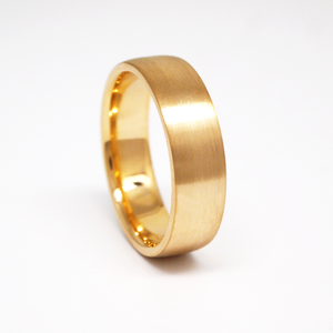 14K yellow gold regular weight 6mm man's wedding band featuring a low dome satin finish.
