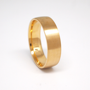 14K yellow gold light weight 6mm men's wedding band featuring a low dome with a satin finish.