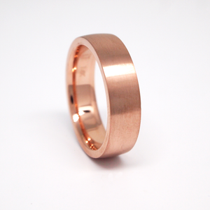 14K rose gold heavy weight 6mm men's wedding band featuring a low dome and satin finish.