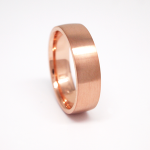 14K rose gold regular weight 6mm men's wedding band featuring a low dome and satin finish.