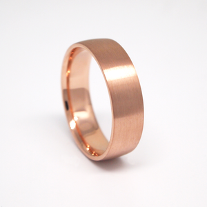 14K rose gold light weight 6mm man's wedding band featuring a low dome and satin finish.