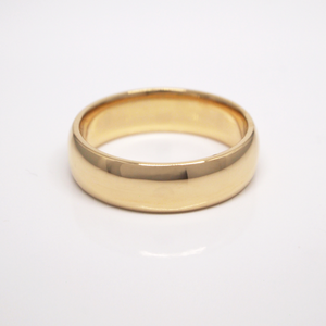 14K yellow gold regular weight 6mm domed wedding band featuring high polish finish.