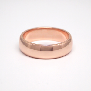14K rose gold regular weight 6mm domed wedding band featuring a high polish finish.