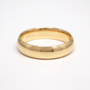 14K yellow gold regular weight 5mm domed men's wedding band featuring a high polish finish.