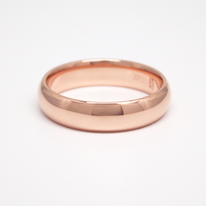 14K rose gold regular weight 5mm domed men's wedding band featuring a high polish finish.