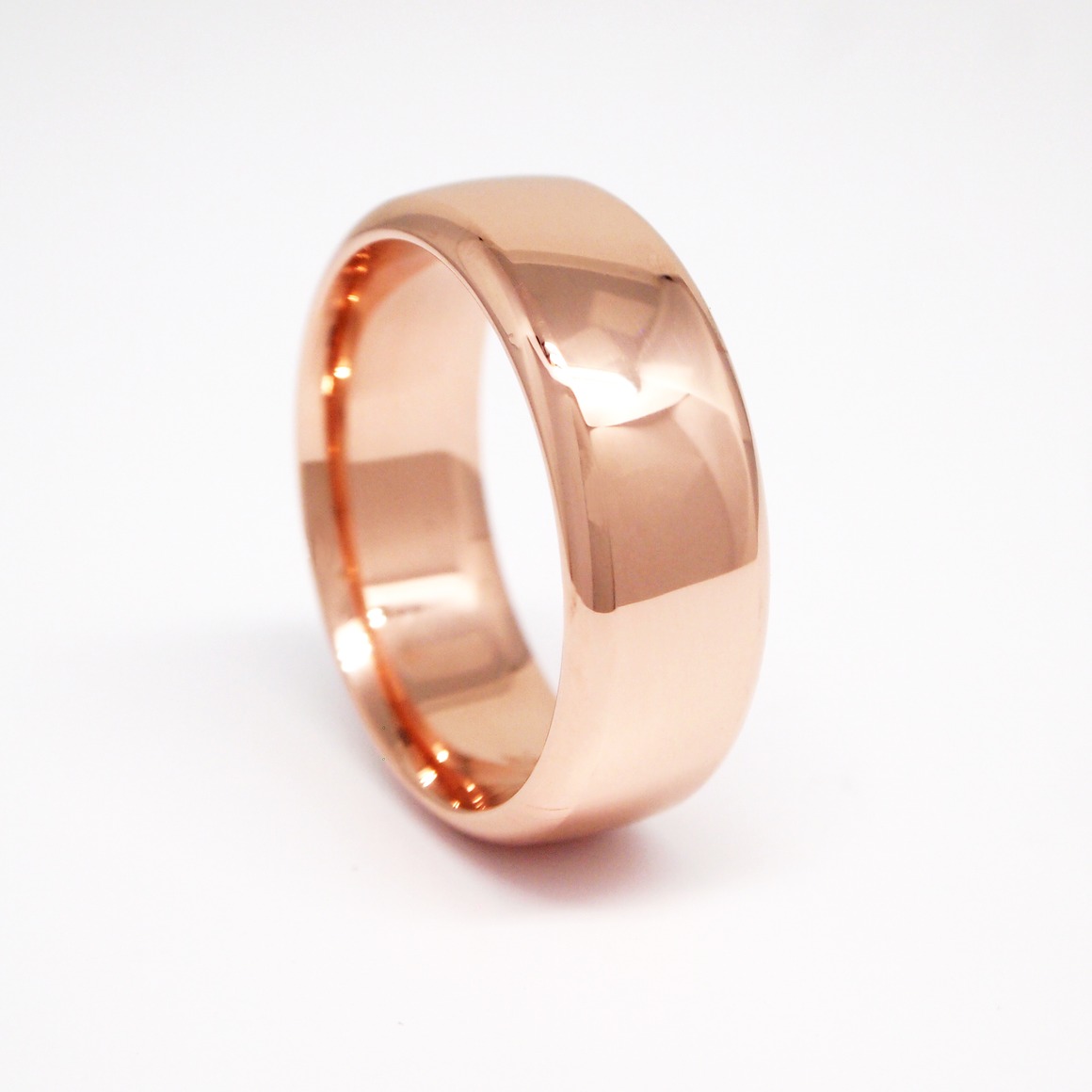 14K rose gold heavy weight 8mm men's wedding band featuring a low dome and high polish finish.