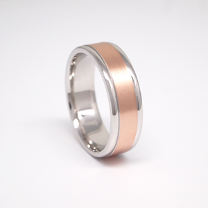 14K rose and white gold 7mm men's wedding band featuring a satin finish center