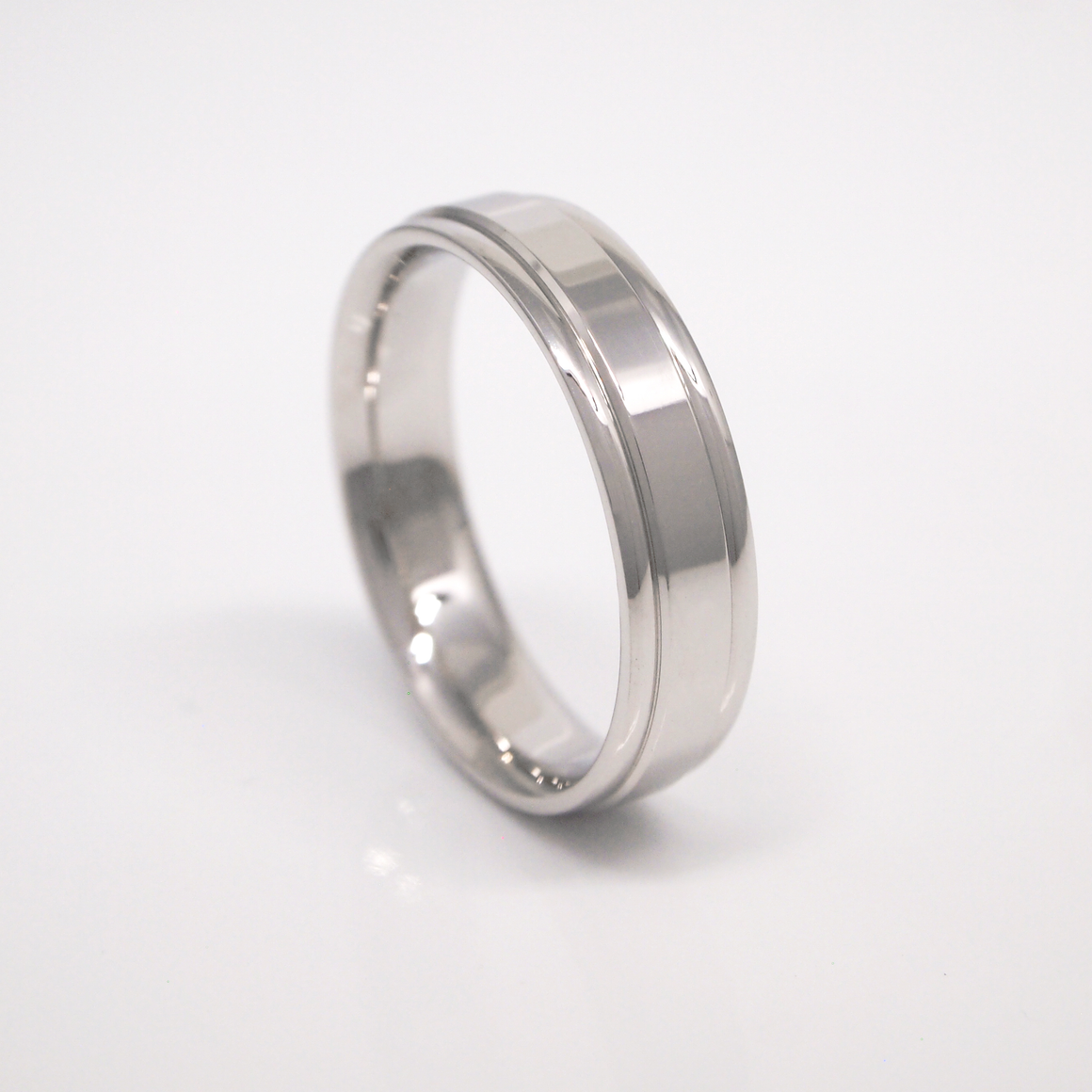 14K white gold 5mm men's wedding band featuring a high polish finish and rolled edges.