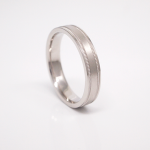 14K white gold 4mm men's wedding band featuring a satin finish center, milgrain channels, and bright edges.