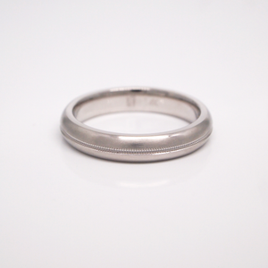 14K white gold 4mm domed men's wedding band featuring a satin finish with a milgrain center.