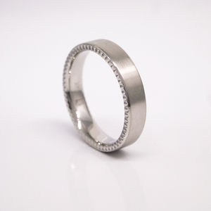14K white gold 5mm pipe-cut men's wedding band featuring a satin finish with engraved sides.