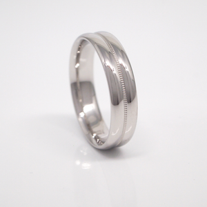 14K white gold 5mm men's wedding band featuring a double dome, high polish, and milgrain center channel.