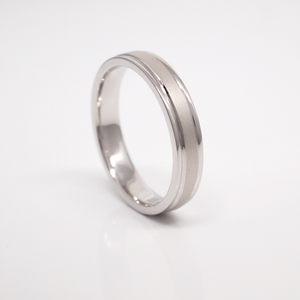 14K white gold 4mm men's wedding band featuring a sandblast center, bright sides, and channels.
