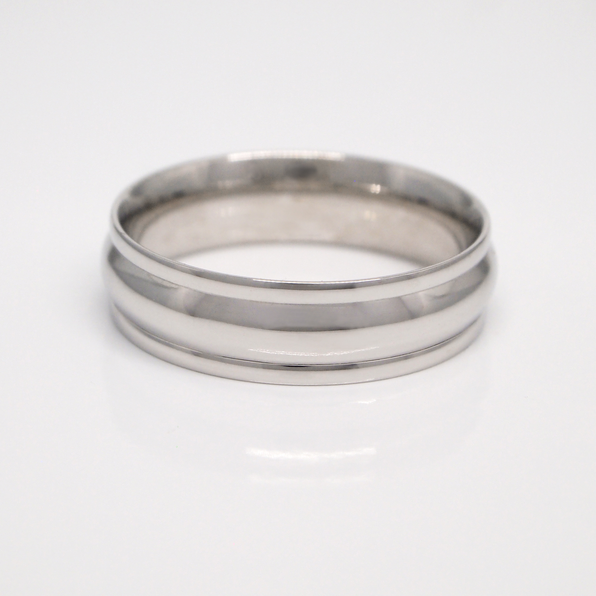 14K white gold 6mm men's wedding band featuring 3 sections and a high polish finish.