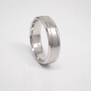 14K white gold 6mm men's wedding band featuring a satin finish, thin bright channels, and bright beveled edges.
