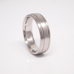 14K white gold 6mm men's wedding band featuring a low dome, satin finish, and bright channels.