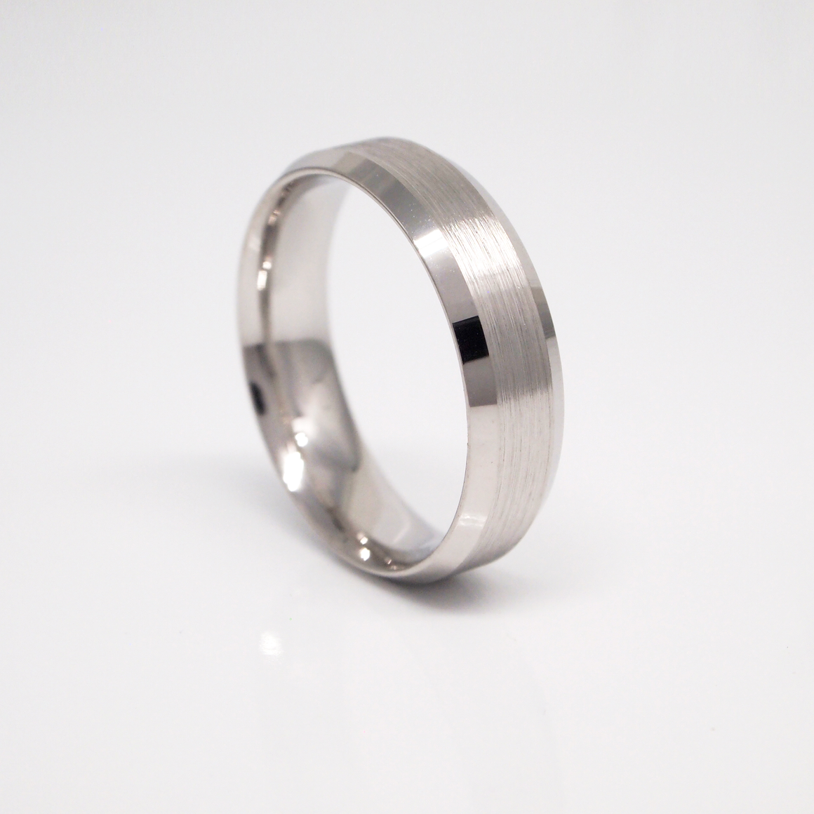 14K white gold 6mm men's wedding band featured a brushed finish center and bright beveled sides.
