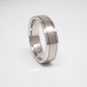 14K white gold 6mm men's wedding band featuring a pipe cut, satin center, bright edges, and channels.