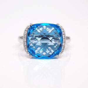 14K white gold blue topaz ring featuring one cushion-cut 12mm blue topaz with checkerboard faceting, and brilliant-cut diamonds