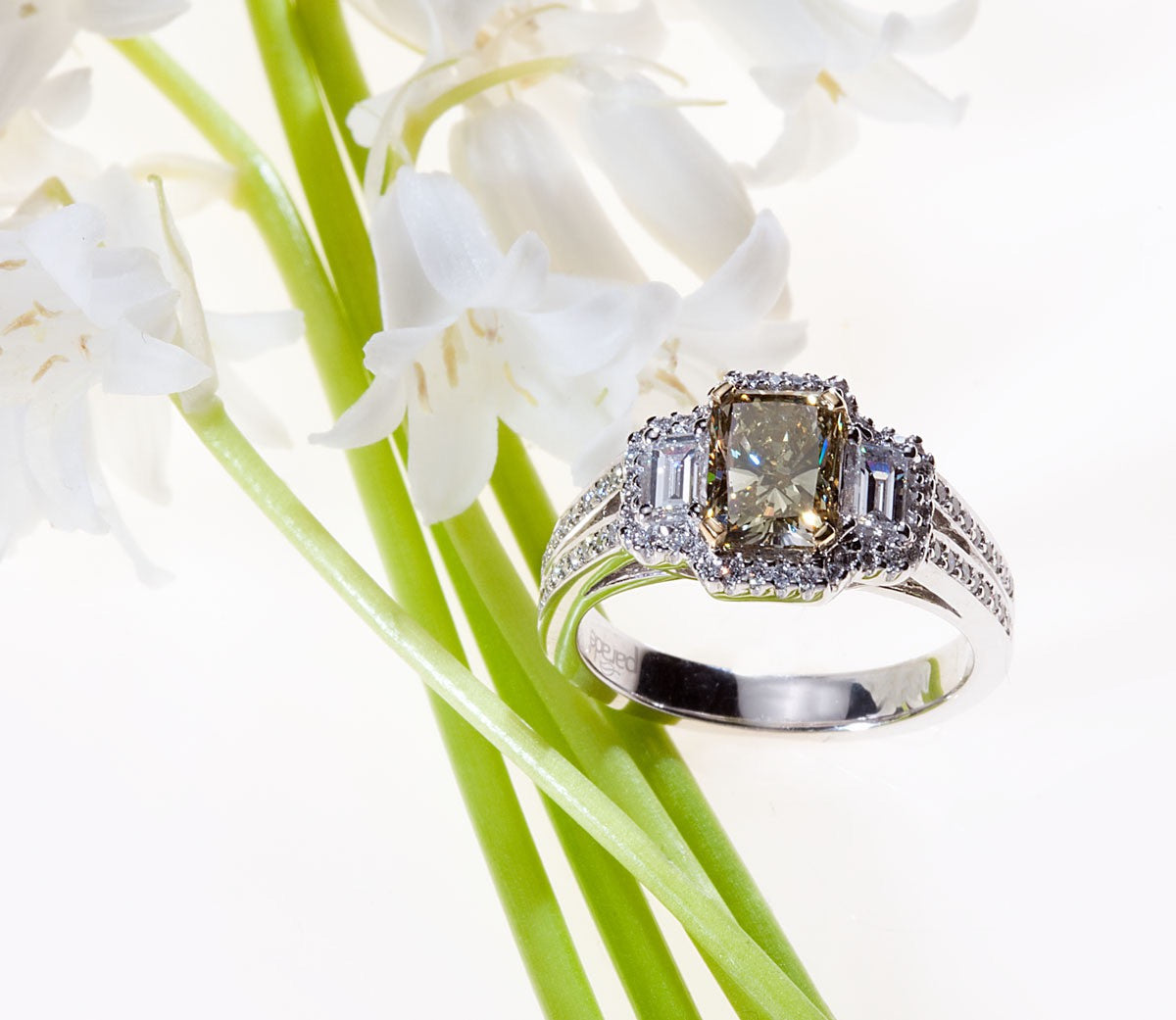White Gold Radiant Cut Yellow-Green Three Stone Diamond Engagement Ring with White Diamonds