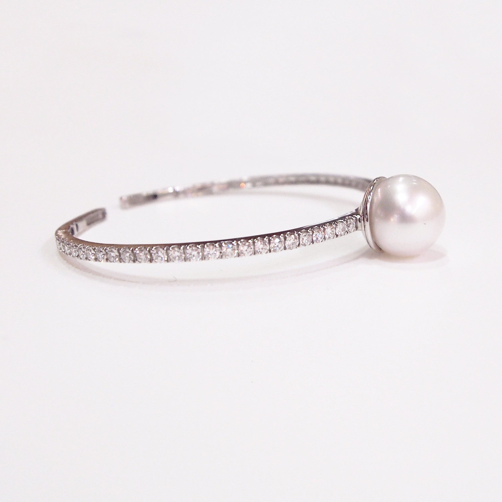18K white gold bangle bracelet with one 13.00 mm South Sea white pearl and 48 round diamonds