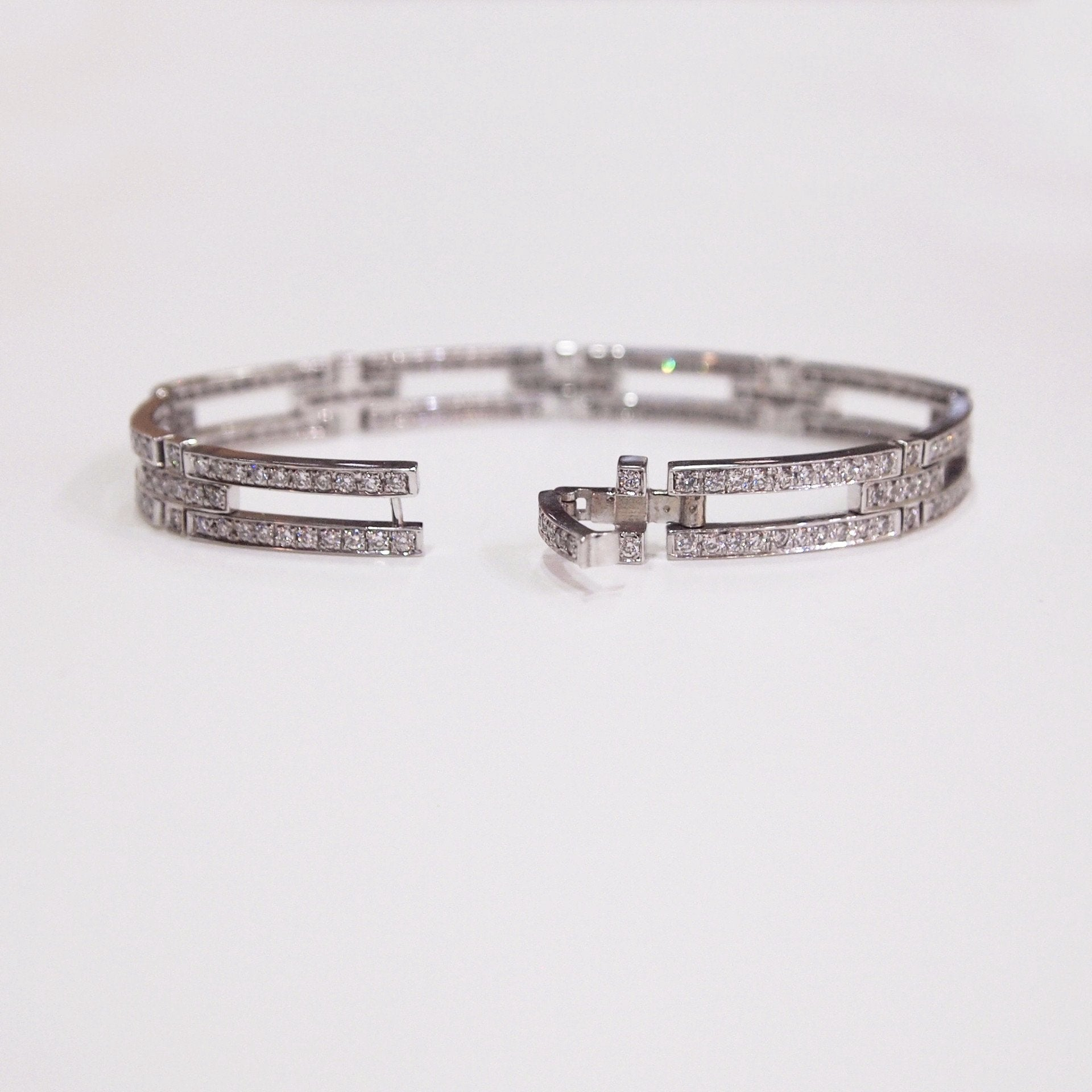 7-inch 18K white gold fancy link bracelet with round diamonds