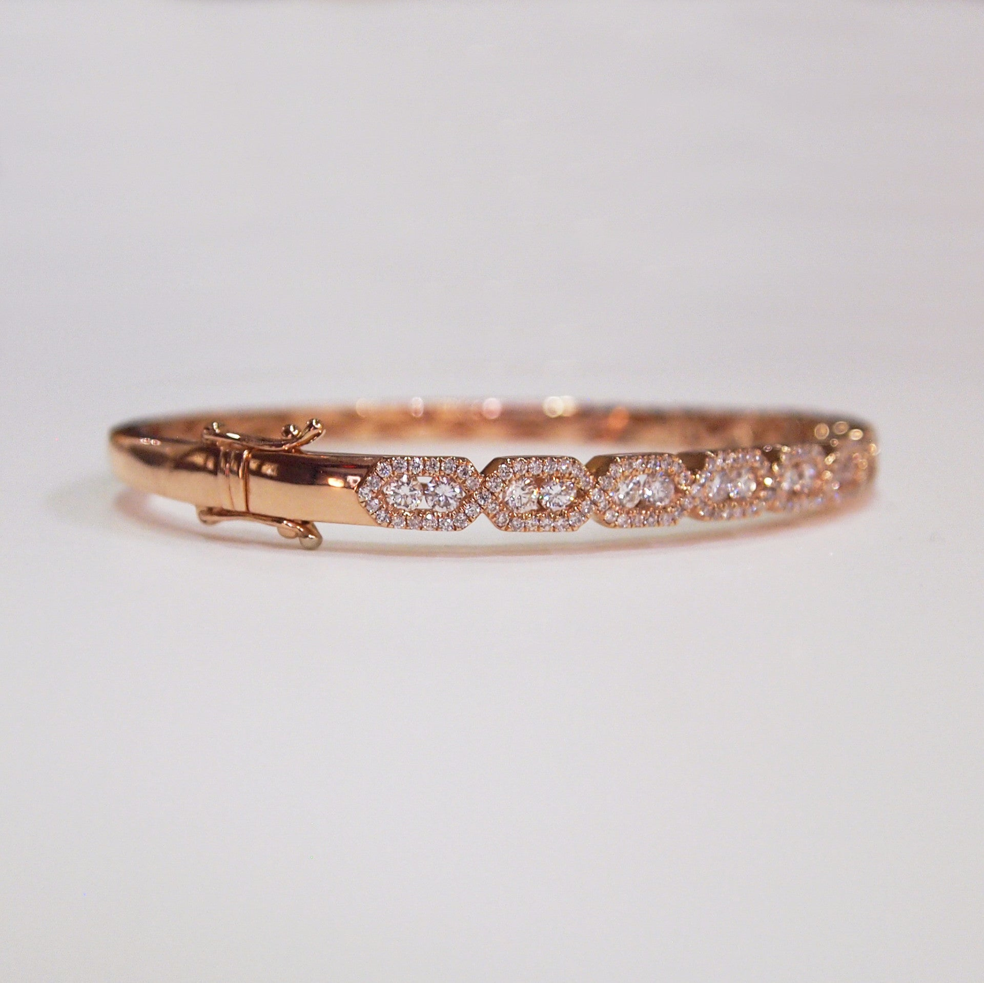14K rose gold and diamond bangle bracelet with brilliant-cut diamonds