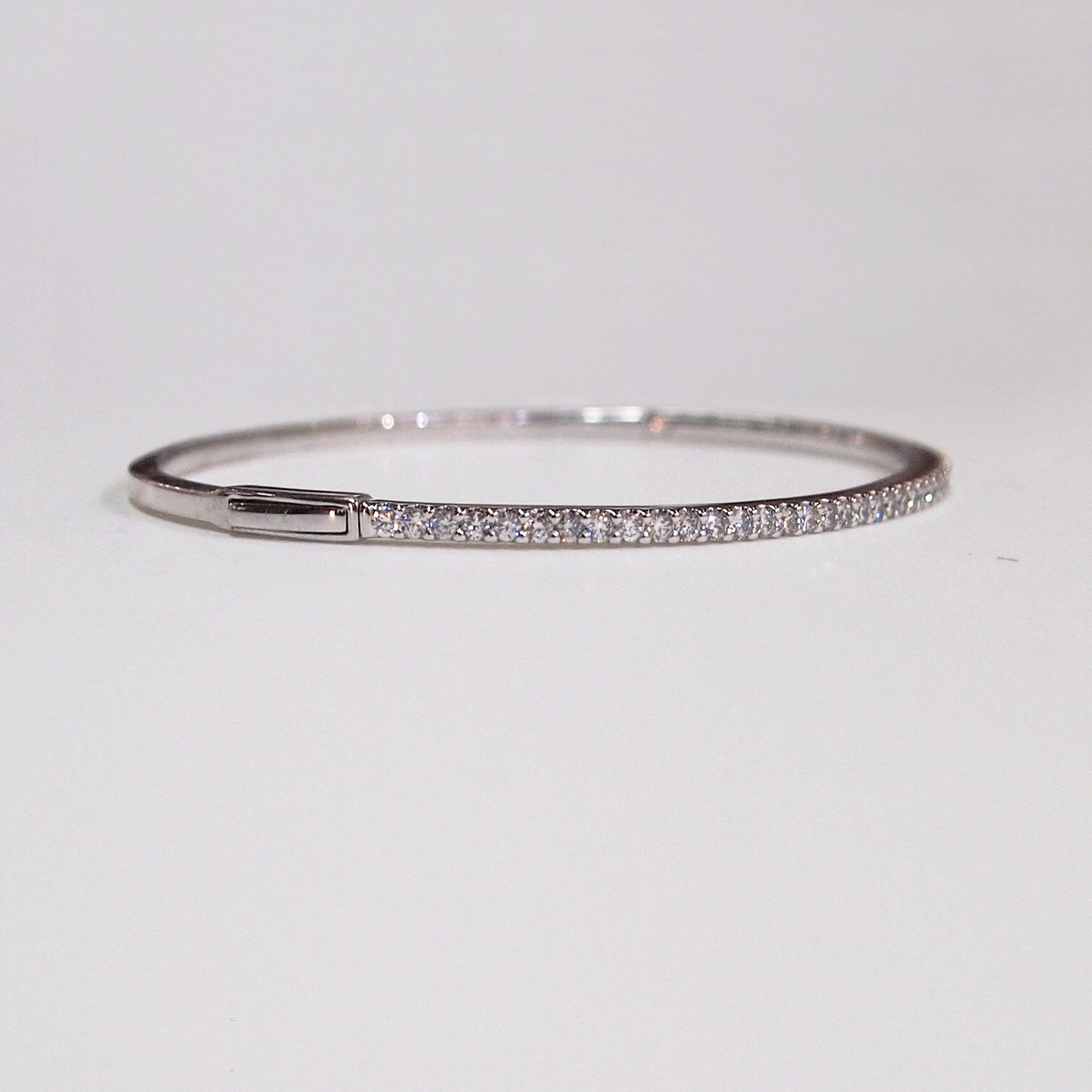 14K white gold bangle bracelet with 49 brilliant cut diamonds