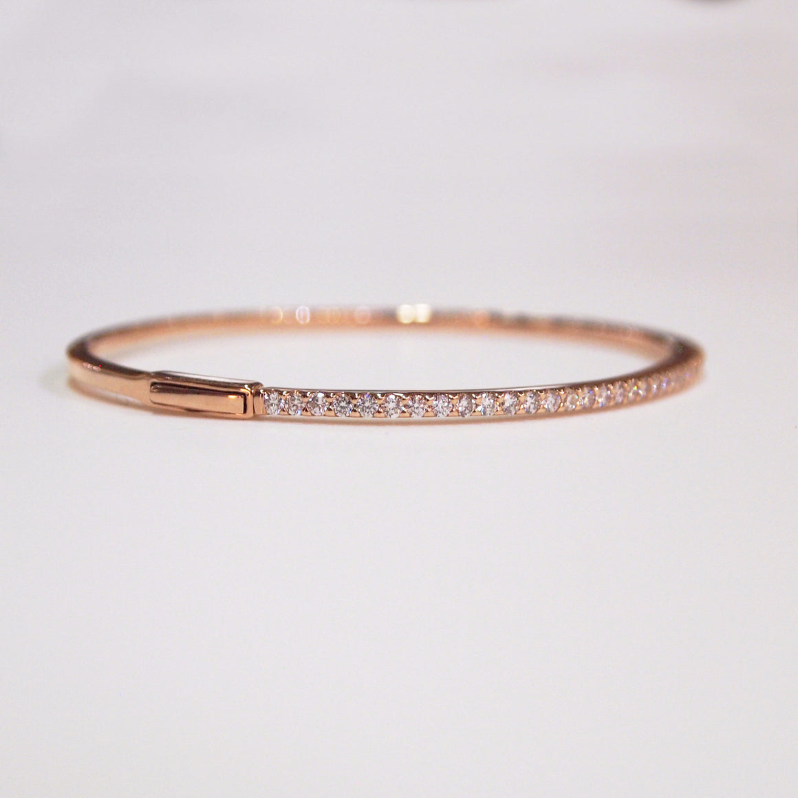 14K rose gold bangle bracelet with 49 brilliant-cut diamonds