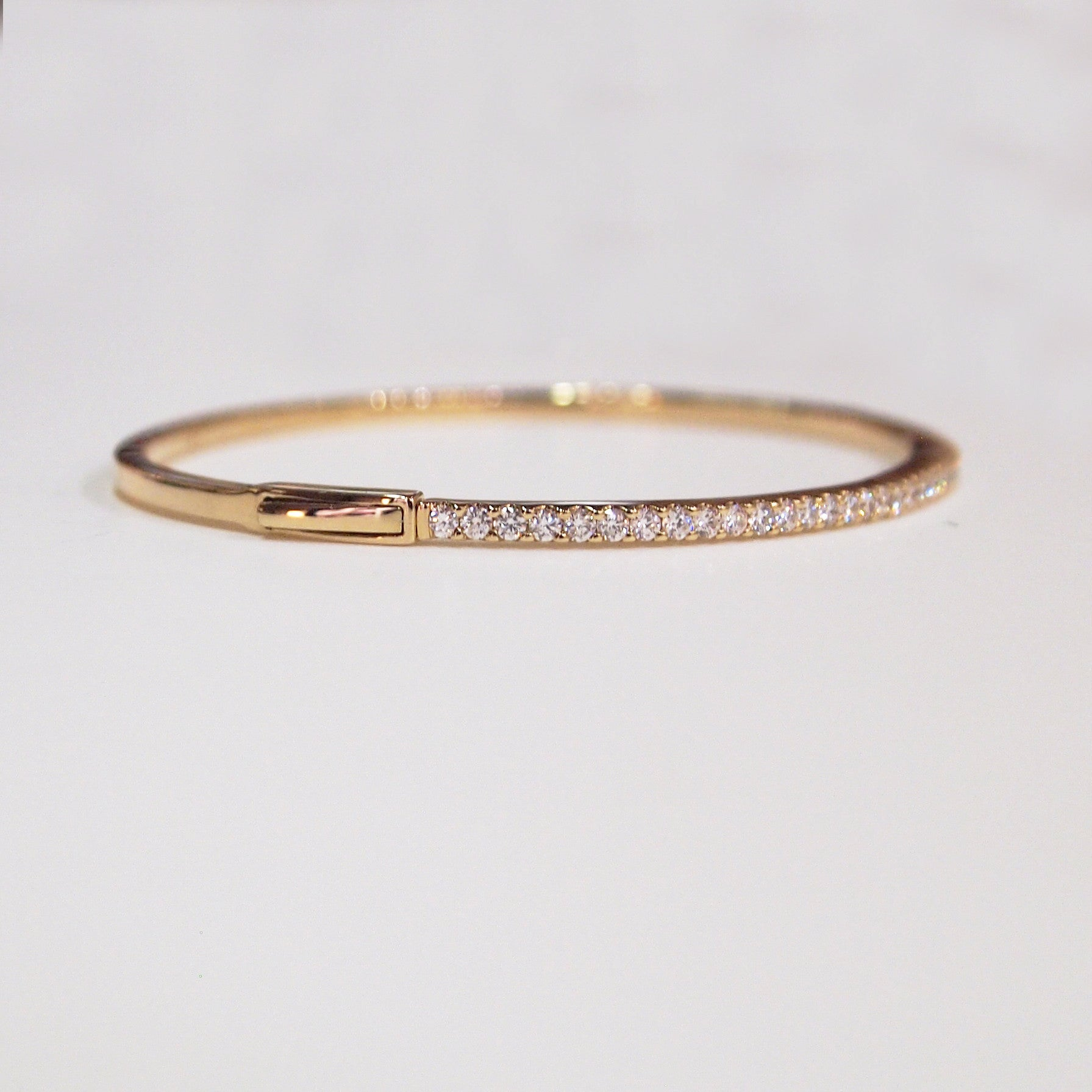 14K yellow gold bangle bracelet with 49 round brilliant cut diamonds