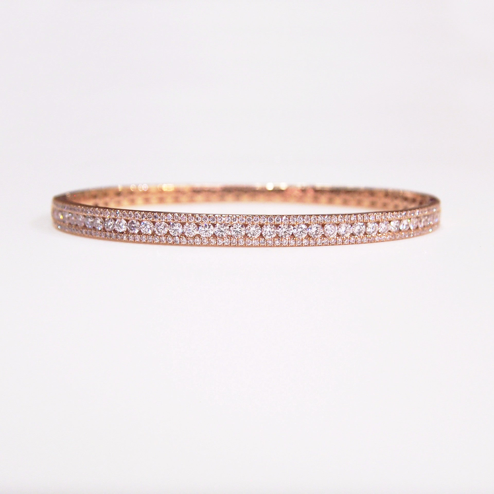 14K rose gold bangle bracelet with 195 round brilliant cut diamonds