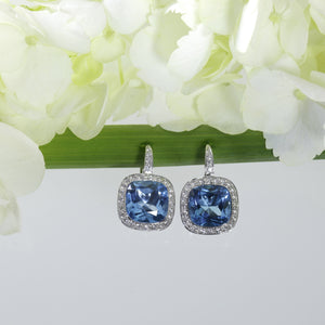 18K white gold earrings with 2 cushion-cut blue topazes and pave-set round diamonds