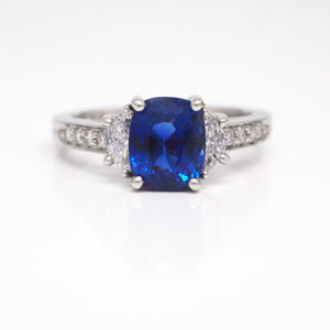 Platinum cushion cut sapphire and diamond engagement ring