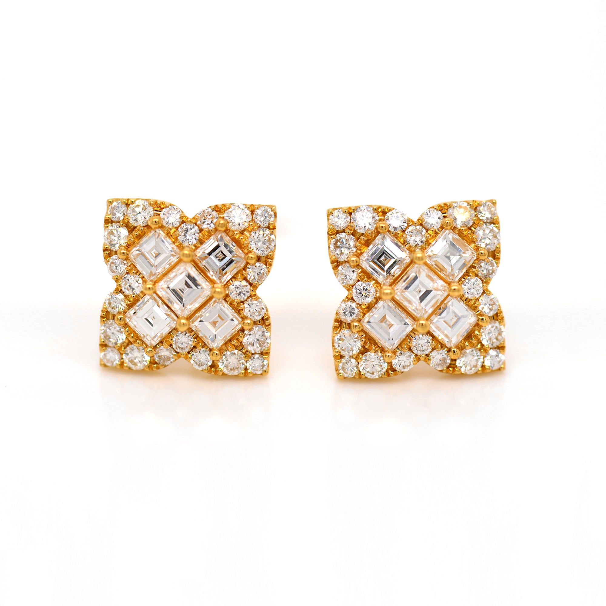 18K yellow gold diamond earrings featuring Asscher and round diamonds weighing a total of 2.78 carats set in a 4-point clover design.