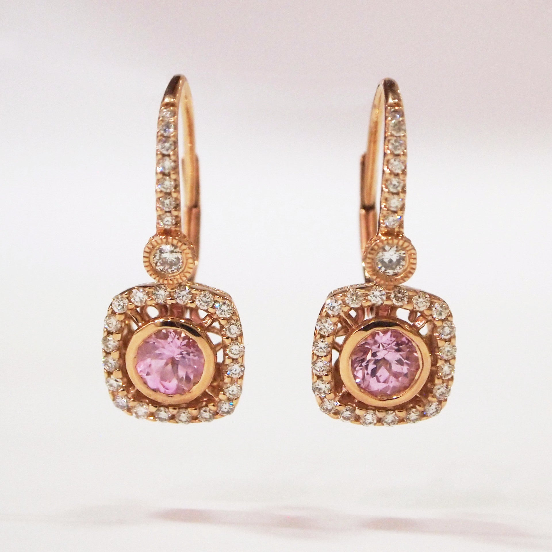 14K pink gold pink sapphire and diamond earrings with 2 pink sapphires and 56 round brilliant-cut diamonds