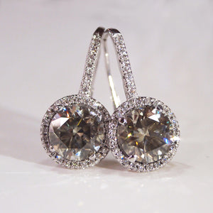 14K white gold lever-back earrings with 2 green-gray diamonds surrounded by a halo of 62 pave-set white brilliant-cut diamonds
