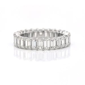 Platinum diamond eternity band featuring 27 emerald-cut diamonds (H color, VS clarity) weighing a total of 4.26 carats.