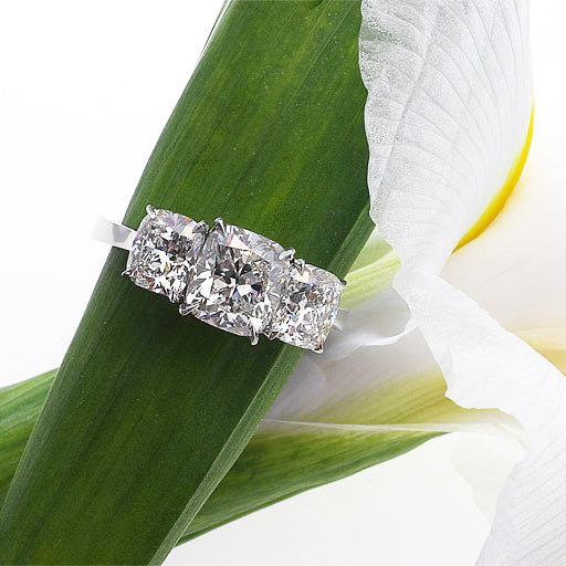 14K diamond engagement ring featuring 3 cushion-cut diamonds in a 4-prong claw setting. Judith Arnell Jewelers