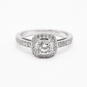 "14K white gold engagement ring with 1 ""Hearts on Fire"" brilliant cushion-cut diamond weighing 0.43 carats, and 35 round brilliant full-cut diamonds weighing a total of 0.26 carats."
