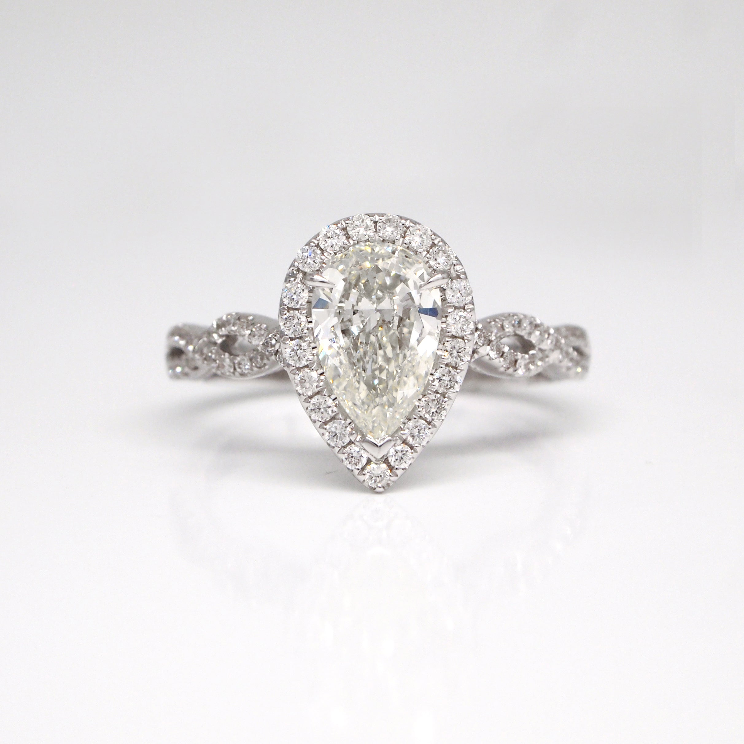 rings wedding diamond shaped platinum mccaul ring collection with twist forged pear engagement goldsmiths