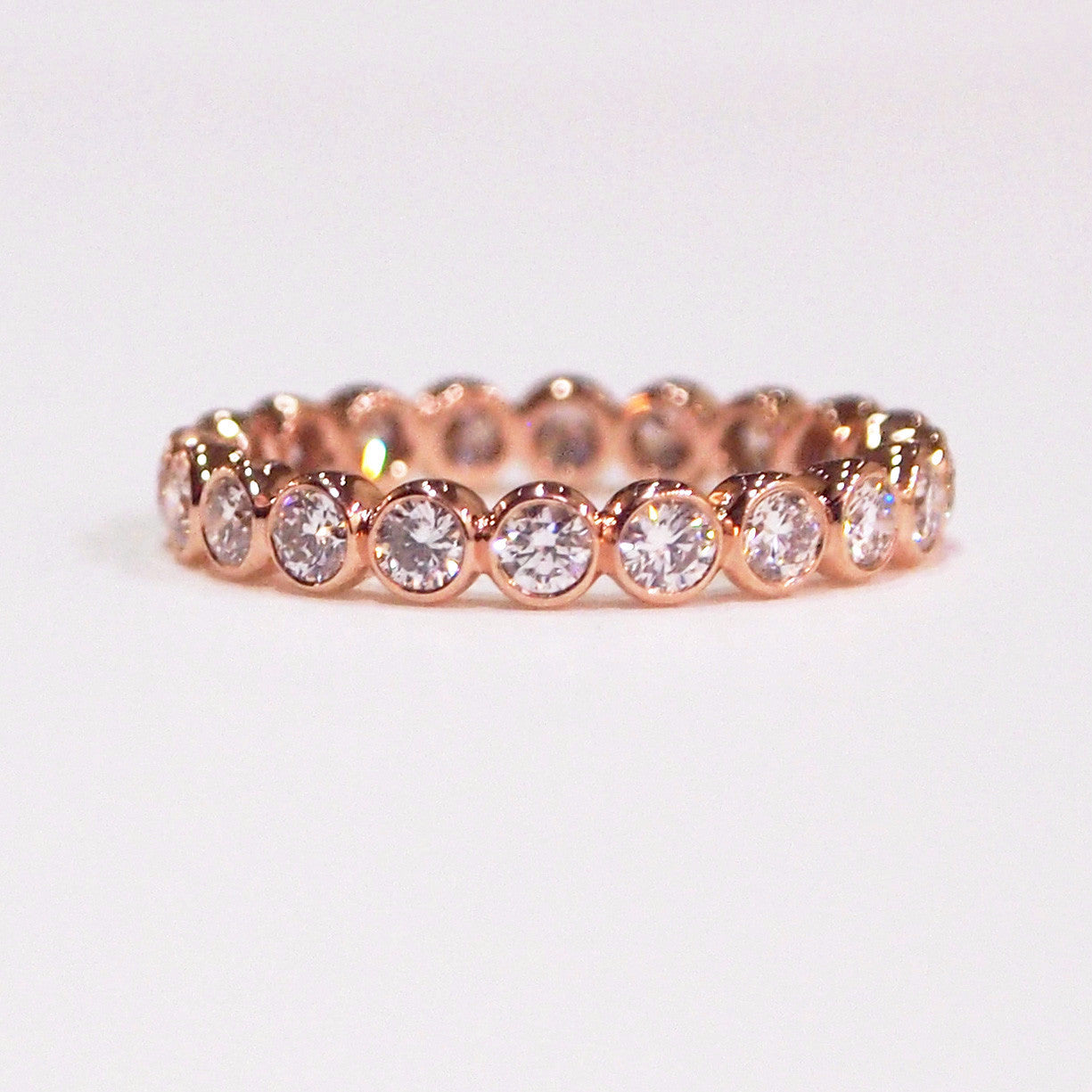 Mark Patterson 18K rose gold eternity diamond wedding band with 20 brilliant-cut bezel-set diamonds