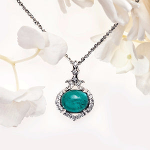 18K white gold pendant with one 7.08 carat cabochon-cut blue-green tourmaline, and round pave-set diamonds
