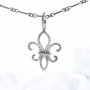 "18K white gold ""Fleur De Lis"" pendant with 84 round diamonds"